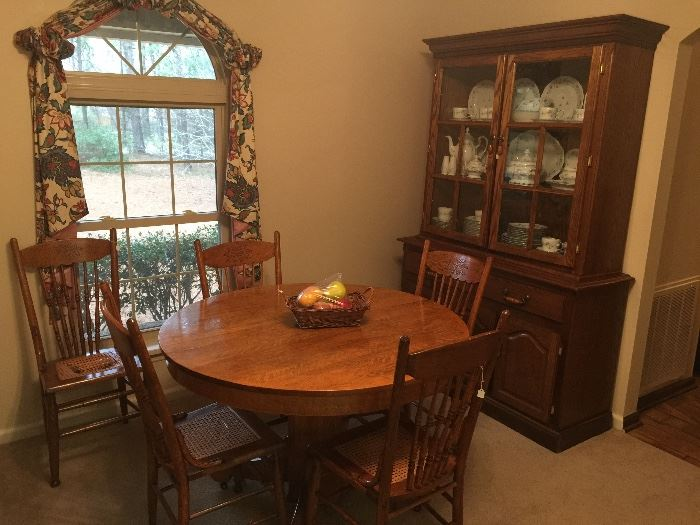 Wooden dining table, great hutch.