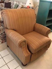 Multi-colored, striped, rolled arm recliner in excellent condition.