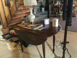 This a walnut harvest-style table -- no leaves.