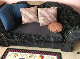 This is one of two matching love seats -- bluish-greenish tones with gold piping.