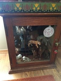I love this little oak display case -- lots of animal treasures inside!