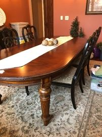 Thomasville oval table, 2 leaves,  6 side chairs, 2 arm chairs,