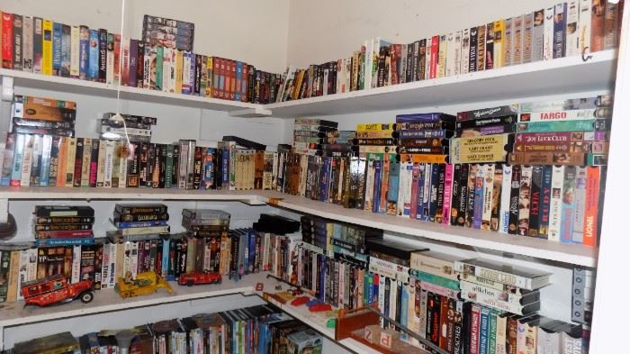 large  collection of VHS tapes...looks like Blockbuster!