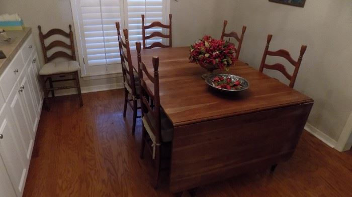 large drop leaf cherry table with 5 tall ladderback chairs