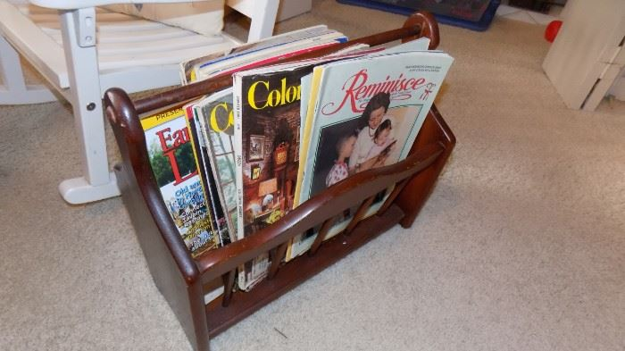 old magazines and wooden rack