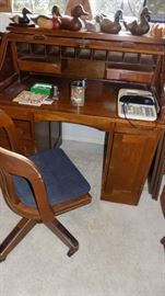 old roll top desk and chair