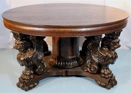 028a  Oak heavily carved dining room table with winged Griffin legs and three 12 in. leaves by R.J. Horner, 54 in. R.