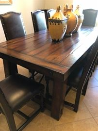 Solid wood, very large dining table with 2 leaves and 8 chairs