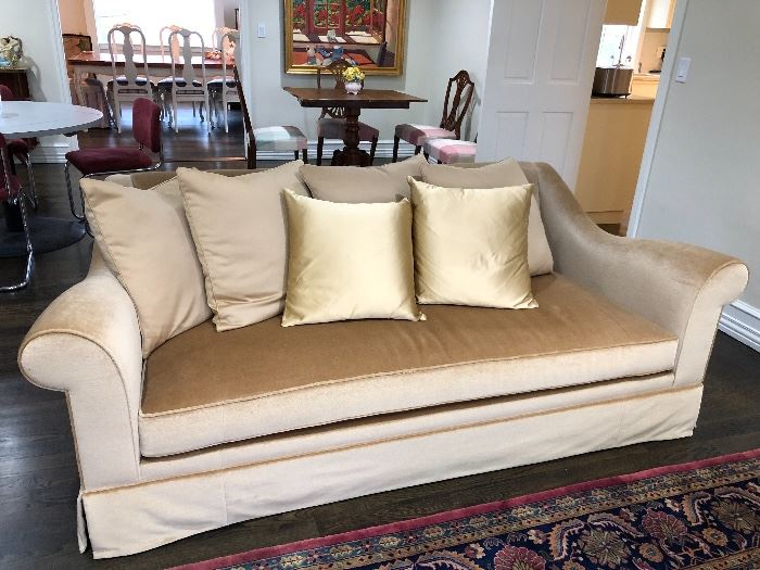 There are two  matching Holly Hunt sofas for sale.