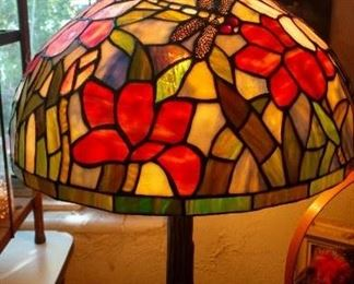 A lovely stained glas lamp with dragonfly design.