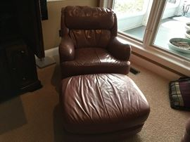 2 leather chairs and ottamans