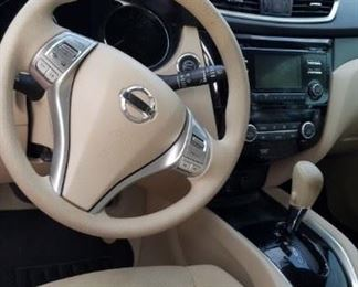 Cloth interior, leather wheel, bluetooth and apps