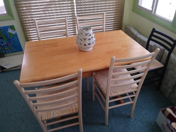 Pier 1 table and 4 rattan seat ladder back chairs