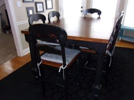 Counter Height Dining rectangle dining room table with 6 chairs and drawer, cushions available for purchase separately. Excellent conditions! Plus two black large area rugs!
