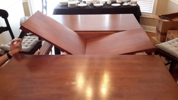 Counter height  rectangle dining room table with 6 chairs and drawers at each end. Cushions available for purchase separately. Drop-in leaf! Excellent condition!