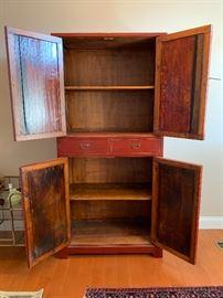Inside storage of 4-door cabinet