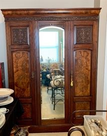 Stunning antique knockdown wardrobe marked A. Gardner and Sons with beveled glass