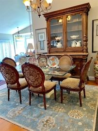 """Glass top dining table with 6 custom upholstered chairs...Surya 'Caesar' wool rug measures 7'6""""x9'6""""."""