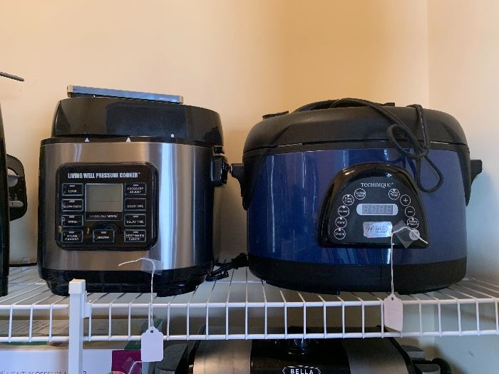 Tons of small appliances....some never used!  Living Well and Technique Pressure Cooker