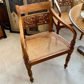 Set of six wooden carved dining chairs with cane seat
