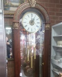 Flawless new Howard Miller Grandfather clock