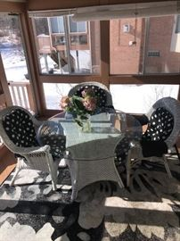 7 - PIECE WICKER ARMCHAIRS AND ROUND TABLE GLASS TOP