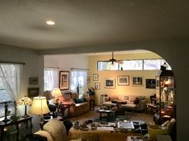 Sunken living room full art Lladros, art, pottery, Armani figures, jewelry etc