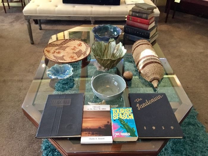 Baskets, Florida related and old books, pottery
