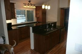 The Thomasville Kitchen Cabinets with Palomino stain finish. The Kitchen Cabinets were installed July of 2017, so they are like new. The cost of cabinets alone were are over $20,000 plus another $4,700 for the Granite. Will have bill of sale at the sale for proof. The set is in excellent condition. In the sale the Island is included.