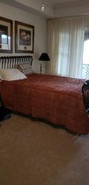 Stearns & Foster queen mattress set, black iron sleigh bed, lamp