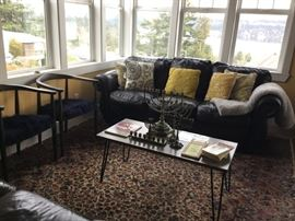 Contemporary Side Chairs (3), Comfy Distressed Leather Sofa, Contemporary Coffee Table, Menorahs and Hanukka Literature, Large Karastan Area Rug.