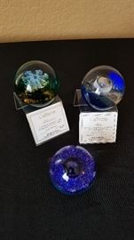 Caithness paperweights. Prices range from $30 (unlimited edition) to $40 (limted edition). Includes original boxes.