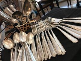 """Westmorland """"Lady Hilton"""" 47-piece set. $750 8 salad forks 9 dinner forks  9 knives 17 teaspoons Sugar spoon Gravy ladle Serving spoon Serving fork"""