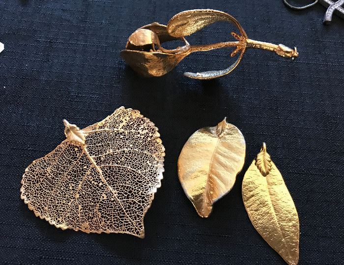 Leaves and a mistletoe dipped in 24K gold. Converted to pendants