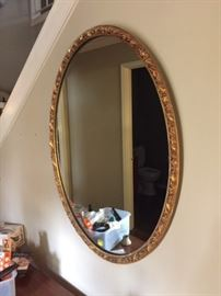 Large wooden oval mirror