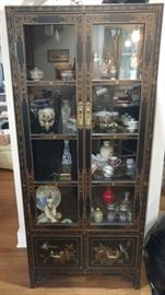 Smaller black lacquer display cabinet