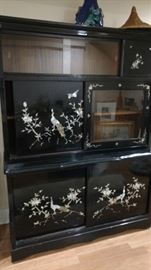 Black lacquer cabinet with sliding doors