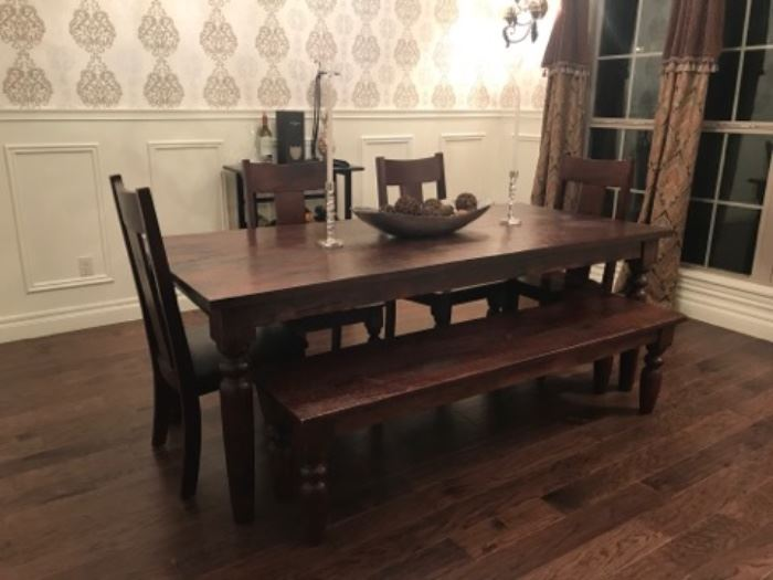 Large, rustic farmers table with bench and chairs