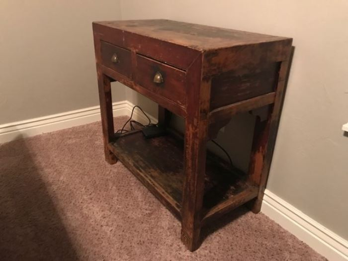 Antique, worn wood table with drawers