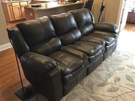 This sofa has electric features for recliners on each end. nice!