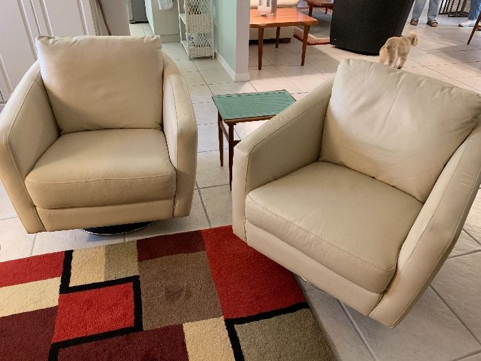 Leather swivel chairs.