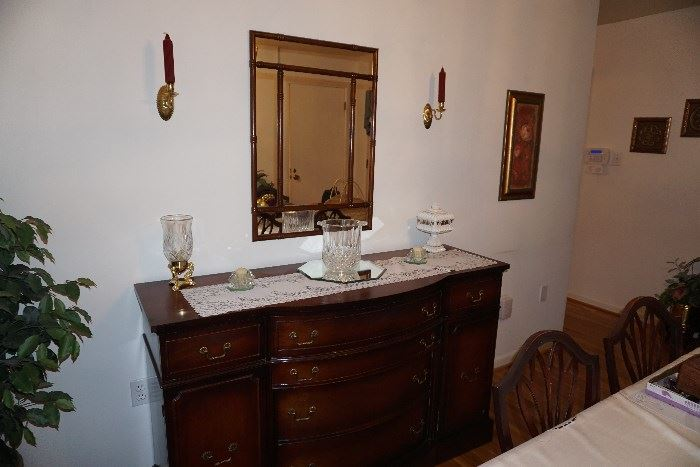 Buffet, mirror, crystal ice bucket, milk glass candy dish, wall sconces and ficus tree