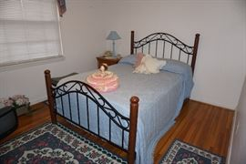 Full bed, vintage phone, night stand, lamp, doll, area rugs