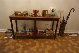 vintage Glass top table with wicker bottom, toby mug, marble cigarette holder and lighter, decorative boxes, Umbrella holder and umbrellas