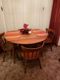 Ethan Allen dining table wit four chairs