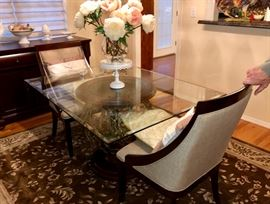 Glass top dining table with scrolled iron base & two chairs
