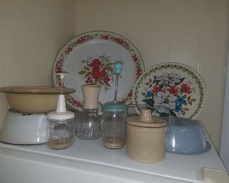 Vintage kitchen including enamelware pans, aluminum painted trays, choppers, & more.