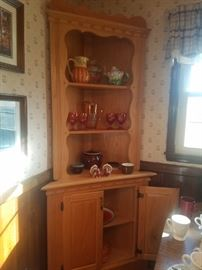 Wooden corner curio cabinet.