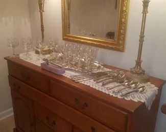 Buffet, Stainless flatware set, crystal, table lamps, mirror, and more.
