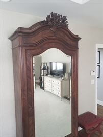 French Antique Wardrobe, ornately carved crest-beveled mirror door, secret door at base c.1880, 43w x 17.5d x 95h